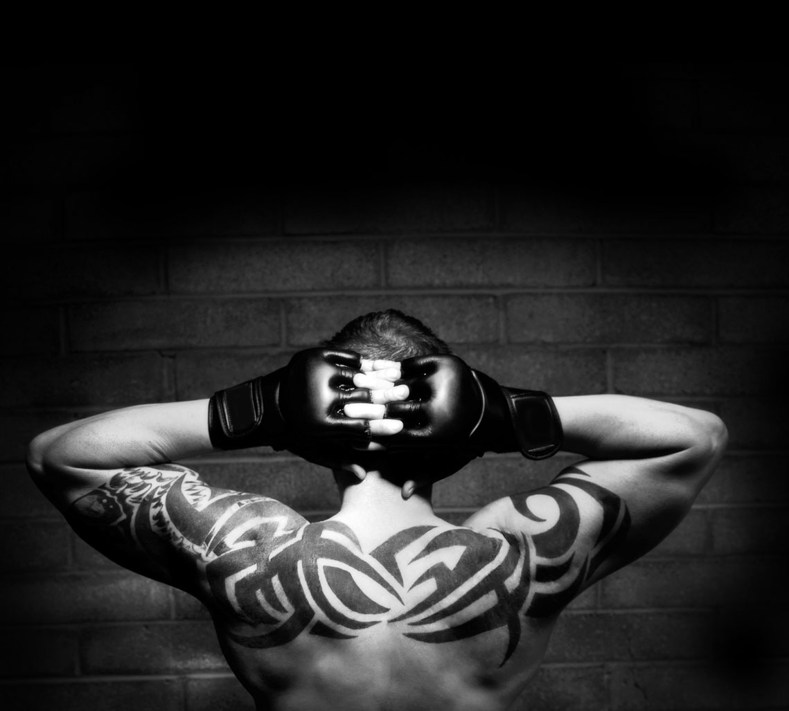 Fighter's tattooed back
